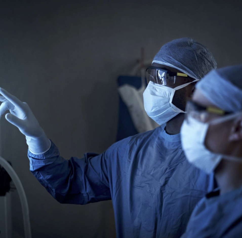 Doctors in surgical masks examining results